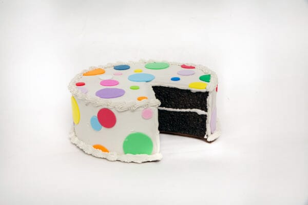 Fake Large Vanilla Frosted Cake with Polka Dots and  Slice Removed